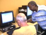 Greg assisting a student with Microsoft Word